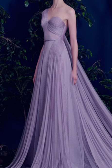 A strap-shouldered cocktail dress ball gown